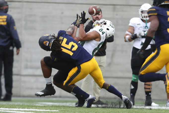 Sacramento State wide receiver Pierre Williams (84) catches a pass over California cornerback Lu-Magia Hearns during the first half of an NCAA college football game on Saturday, Sept. 18, 2021, in Berkeley, Calif. (AP Photo/Jed Jacobsohn)