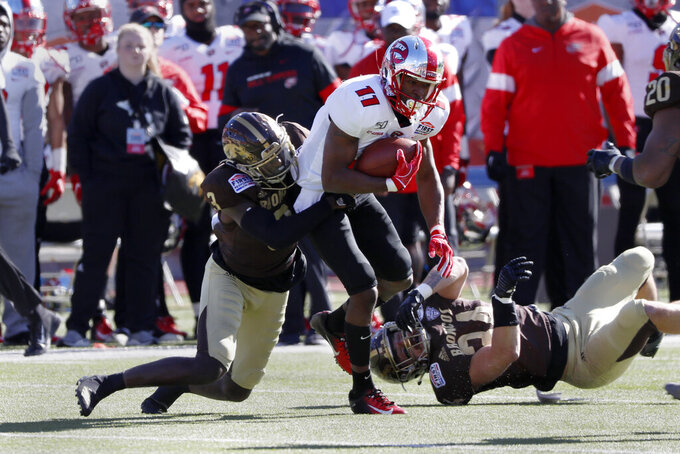 Western Kentucky wide receiver Lucky Jackson (11) is tackled by Western Michigan cornerback Anton Curtis (3) after a reception during the first half of the NCAA First Responder Bowl college football game in Dallas, Monday, Dec. 30, 2019. (AP Photo/Roger Steinman)