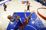 Philadelphia 76ers' Jimmy Butler (23) goes up for a shot against Miami Heat's Rodney McGruder (17) during the first half of an NBA basketball game Thursday, Feb. 21, 2019, in Philadelphia. (AP Photo/Matt Slocum)