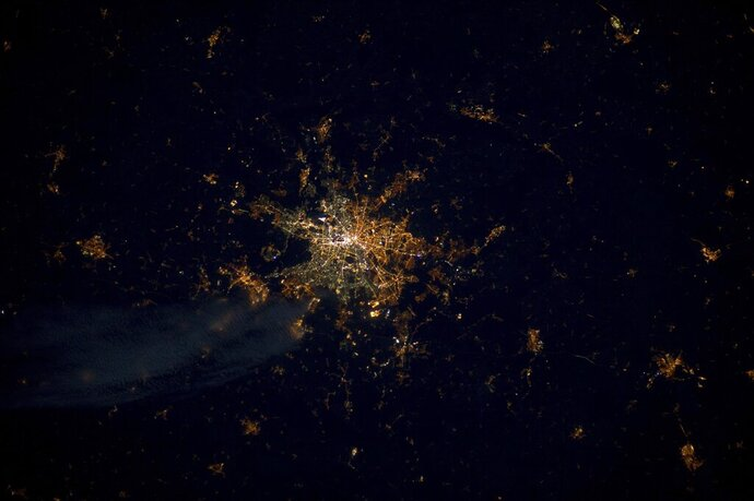 This undated photo provide by the European Space Agency and captured by ESA astronaut Andre Kuipers, shows the German capital Berlin from the International Space Station, ISS. Seen from above, street lights in the former East Berlin appear slightly more orange; those in the western part of the city are a harsher yellow. (ESA via AP)