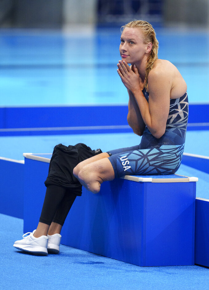 Jessica Long of the U.S. sits on the side of the pool after the Women's 100m Backstroke - S8 Final Swimming, at the Tokyo 2020 Paralympic Games in Tokyo Friday, Aug. 27, 2021. (Thomas Lovelock for OIS via AP)