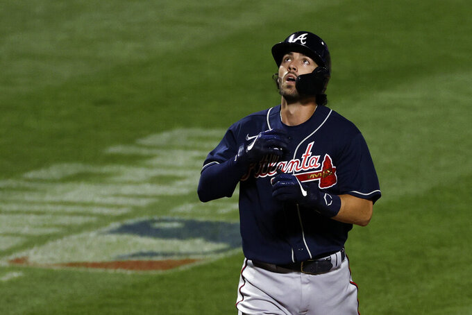 Atlanta Braves' Dansby Swanson celebrates after hitting a two-run home run against the New York Mets during the fourth inning of a baseball game Sunday, July 26, 2020, in New York. (AP Photo/Adam Hunger)