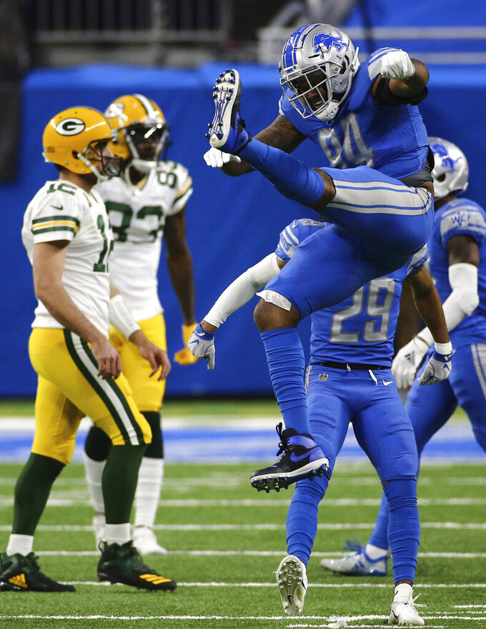Detroit Lions defensive end Austin Bryant (94) jumps as he celebrates a tackle during the second half of an NFL football game against the Green Bay Packers, Sunday, Dec. 13, 2020, in Detroit. (AP Photo/Leon Halip)