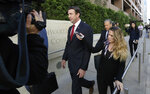 FILE - In this Dec. 3, 2018 file photo, Republican Rep. Duncan Hunter, center, leaves court in San Diego. The wife of U.S. Rep. Duncan Hunter pleaded guilty Thursday, June 13, 2019 to a single corruption count and agreed to testify against her husband at his trial on charges the couple spent more than $200,000 in campaign funds on trips, dinners, clothes and other personal expenses.  (AP Photo/Gregory Bull,File)