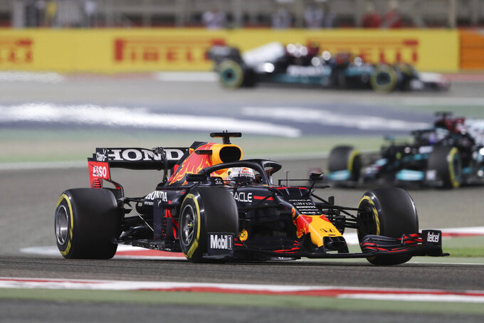 Red Bull driver Max Verstappen of the Netherlands followed by Mercedes driver Lewis Hamilton of Britain steers his car during the Bahrain Formula One Grand Prix at the Bahrain International Circuit in Sakhir, Bahrain, Sunday, March 28, 2021. (AP Photo/Kamran Jebreili)