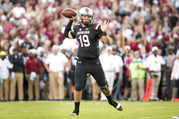 South Carolina quarterback Jake Bentley (19) attempts a pass during the second half of an NCAA college football game against Texas A&M Saturday, Oct. 13, 2018, in Columbia, S.C. Texas A&M defeated South Carolina 26-23. (AP Photo/Sean Rayford)