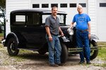 In this Tuesday, Aug. 27, 2019 photo, Lane Nelson, left, and his dad, Ron Nelson pose with a refurbished Model A car in Wahoo, Neb. (Ryan Soderlin/Omaha World-Herald via AP)