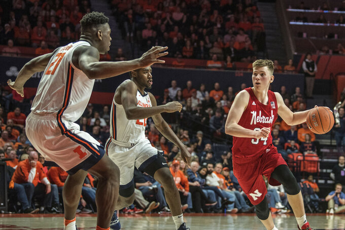 Nebraska's Thorir Thorbjarnarson (34) drives as illinois' Damonte Williams (20) and Kofi Cockburn (21) defend in the second half of an NCAA college basketball game Monday, Feb. 24, 2020, in Champaign, Ill. (AP Photo/Holly Hart)