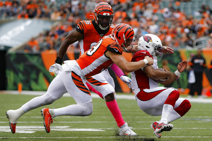 Arizona Cardinals quarterback Kyler Murray, right, is tackled by Cincinnati Bengals outside linebacker Nick Vigil, left, in the second half of an NFL football game, Sunday, Oct. 6, 2019, in Cincinnati. (AP Photo/Frank Victores)