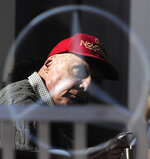 FILE - In this Friday, Feb. 20, 2015 file photo former Austrian Formula One driver Niki Lauda is pictured through a glass window, during the 2015 Formula One testing, at the Barcelona Catalunya racetrack in Montmelo, Spain. Three-time Formula One world champion Niki Lauda, who won two of his titles after a horrific crash that left him with serious burns and went on to become a prominent figure in the aviation industry, has died. He was 70. (AP Photo/Manu Fernandez, File)
