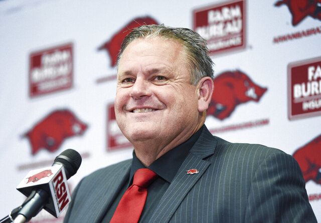 FILE - In this Monday, Dec. 9, 2019, file photo, new Arkansas NCAA college football head coach Sam Pittman speaks during an introductory news conference in Fayetteville, Ark. Kirby Smart gives much credit to first-year Arkansas coach Sam Pittman for helping to make No. 4 Georgia an annual contender for the Southeastern Conference championship. Georgia opens its season at Arkansas on Saturday, Sept. 26, 2020, in Pittman's debut as the Razorbacks coach. Pittman was one of Smart's top assistants as the Bulldogs' offensive line coach for four seasons. (Charlie Kaijo/The Northwest Arkansas Democrat-Gazette via AP, File)