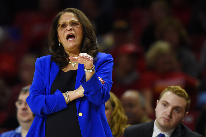 FILE - In this Dec. 31, 2018, file photo, Rutgers coach C. Vivian Stringer directs her team during the first half of an NCAA college basketball game against Maryland, in Baltimore. In the 2020-21 basketball season, Stringer will be entering her 50th season as a college coach, including the last 26th at Rutgers. The Hall of Famer will be the first NCAA women's basketball coach ever to coach 50 seasons and just the fourth men's or women's basketball coach in any NCAA division to reach that milestone. (AP Photo/Gail Burton, File)