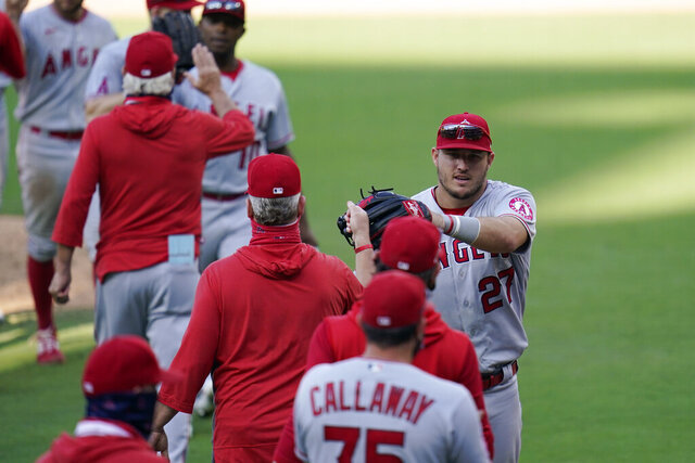 Los Angeles Angels center fielder Mike Trout, right, celebrates with teammates after the Angels defeated the San Diego Padres in a baseball game Wednesday, Sept. 23, 2020, in San Diego. (AP Photo/Gregory Bull)