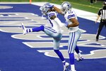 Dallas Cowboys wide receiver CeeDee Lamb (88) and wide receiver Amari Cooper (19) celebrate a touchdown catch by Lamb in the second half of an NFL football game against the Philadelphia Eagles in Arlington, Texas, Sunday, Dec. 27. 2020. (AP Photo/Ron Jenkins)