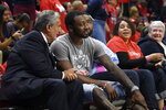 Washington Mystics and Wizards owner Ted Leonsis, left, talks with Wizards' John Wall during a break in the first half of Game 1 of a WNBA playoff basketball series between the Mystics and the Las Vegas Aces, Tuesday, Sept. 17, 2019, in Washington. (AP Photo/Nick Wass)