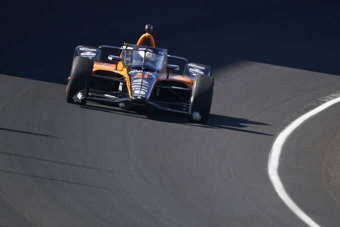 Pato O'Ward, of Mexico, drives into the turn during a practice session for the Indianapolis 500 auto race at Indianapolis Motor Speedway, Sunday, Aug. 16, 2020, in Indianapolis. (AP Photo/Darron Cummings)