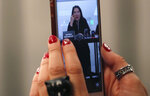 A journalist takes a photo with his phone during the press conference of performance artist Marina Abramovic, for the art exhibition