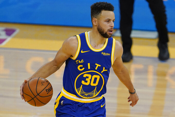 Golden State Warriors guard Stephen Curry (30) dribbles against the Utah Jazz during the first half of an NBA basketball game in San Francisco, Sunday, March 14, 2021. (AP Photo/Jeff Chiu)