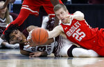 Bradley's Nate Kennell (25) and Missouri State's Tulio Da Silva dive after a loose ball during the second half of an NCAA college basketball game in the quarterfinal round of the Missouri Valley Conference tournament, Friday, March 8, 2019, in St. Louis. Bradley won 61-58. (AP Photo/Jeff Roberson)