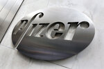 File- This Dec. 4, 2017, photo shows the Pfizer company logo at the company's headquarters in New York.  The federal government has agreed to pay nearly $2 billion for 100 million doses of a potential COVID-19 vaccine being developed by the U.S. drugmaker and its German partner BioNTech.  (AP Photo/Richard Drew, File)