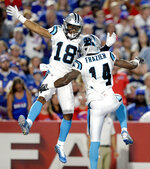 Carolina Panthers wide receiver Mose Frazier (14) celebrates his touchdown catch with wide receiver Damiere Byrd (18) during the second half of an NFL football game against the Buffalo Bills, Thursday, Aug. 9, 2018, in Orchard Park, N.Y. (AP Photo/Adrian Kraus)