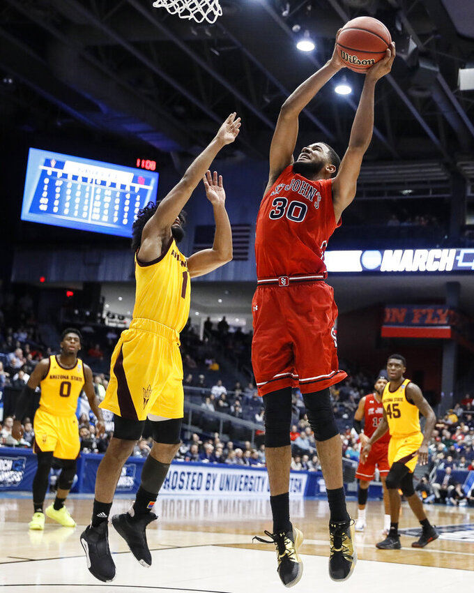 St. John's LJ Figueroa (30) shoots against Arizona State's Remy Martin (1) during the second half of a First Four game of the NCAA men's college basketball tournament Wednesday, March 20, 2019, in Dayton, Ohio. (AP Photo/John Minchillo)