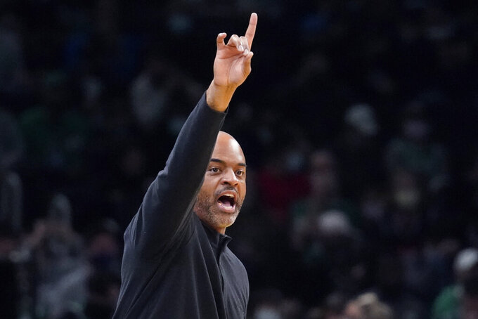Washington Wizards head coach Wes Unseld Jr. calls to his players during the first half of an NBA basketball game against the Boston Celtics, Wednesday, Oct. 27, 2021, in Boston. (AP Photo/Charles Krupa)
