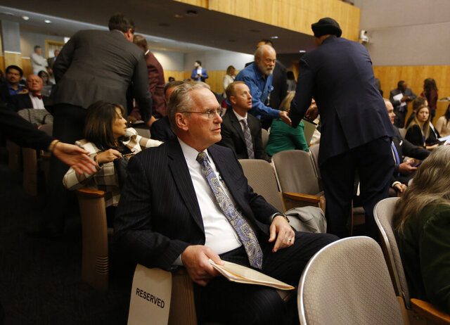 Pacific Gas & Electric CEO Bill Johnson waits to appear before a state Senate oversight hearing of the Energy, Utilities and Communications committee, at the Capitol in Sacramento, Calif., Monday, Nov. 18, 2019. Johnson is scheduled to testify before lawmakers about the utilities' decision to turnoff power for millions of people to prevent California wildfires. (AP Photo/Rich Pedroncelli)