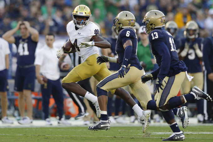 Notre Dame wide receiver Kevin Austin Jr. runs with the ball after a reception during the first half of an NCAA college football game against Navy Saturday, Oct. 27, 2018, in San Diego. (AP Photo/Gregory Bull)