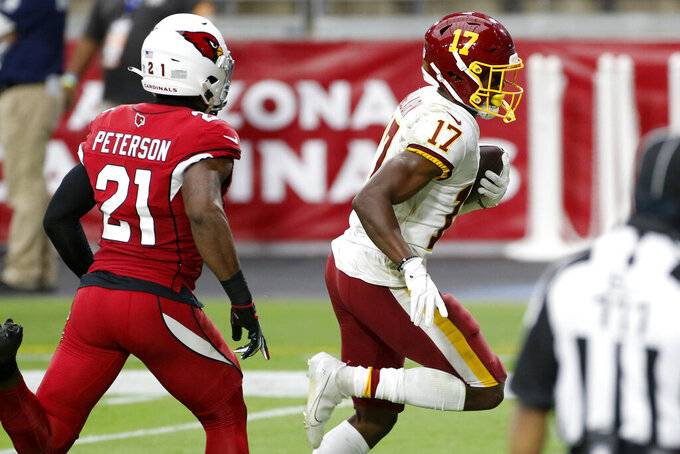 Washington Football Team wide receiver Terry McLaurin (17) scores a touchdown as Arizona Cardinals cornerback Patrick Peterson (21) defends during the second half of an NFL football game, Sunday, Sept. 20, 2020, in Glendale, Ariz. (AP Photo/Darryl Webb)