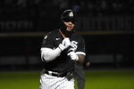 Chicago White Sox's Yoan Moncada celebrates while running the bases on a home run off Los Angeles Angels starting pitcher Janson Junk as the stadium lights flicker in a strobe-light fashion during the fourth inning of a baseball game Wednesday, Sept. 15, 2021, in Chicago. (AP Photo/Charles Rex Arbogast)