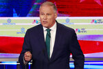 FILE - In this June 26, 2019, file photo, Democratic presidential candidate Washington Gov. Jay Inslee speaks during a Democratic primary debate hosted by NBC News in Miami. Plagued by anemic polling and fundraising, many 2020 Democratic presidential campaigns have fallen into a spiral of perceived struggles that become increasingly self-fulfilling. That includes New York Sen. Kirsten Gillibrand's championing of women's rights, Inslee's focus on climate change and former Colorado Gov. John Hickenlooper's pitch as a principled moderate. (AP Photo/Wilfredo Lee, File)
