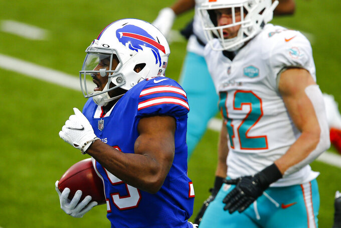 Buffalo Bills wide receiver Isaiah McKenzie (19) runs for a touchdown after catching a short pass in the first half of an NFL football game against the Miami Dolphins, Sunday, Jan. 3, 2021, in Orchard Park, N.Y. (AP Photo/John Munson)