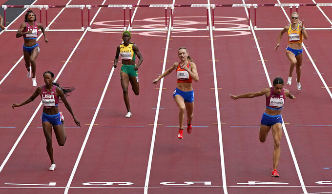 Sydney Mclaughlin, of United States wins the gold medal in the final of the the women's 400-meter hurdles ahead of Dalilah Muhammad, of United States, silver, and Femke Bol, of Netherlands, bronze, at the 2020 Summer Olympics, Wednesday, Aug. 4, 2021, in Tokyo, Japan. (AP Photo/Charlie Riedel)