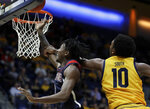Arizona's Dylan Smith, left, lays up a shot past California's Kareem South (10) during the second half of an NCAA college basketball game Thursday, Feb. 13, 2020, in Berkeley, Calif. (AP Photo/Ben Margot)