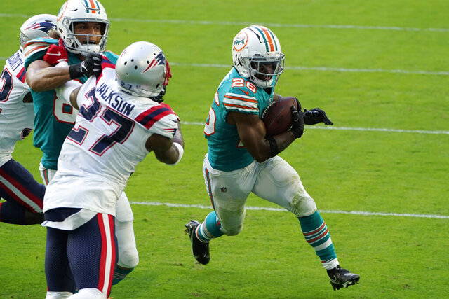 Miami Dolphins running back Salvon Ahmed (26) runs for a two-point conversion during the second half of an NFL football game against the New England Patriots, Sunday, Dec. 20, 2020, in Miami Gardens, Fla. (AP Photo/Chris O'Meara)
