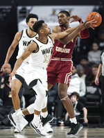 Wake Forest guard Andrien White (13) knocks the ball away from Boston College forward Jairus Hamilton (1) in the first half of a college basketball game  Sunday, Jan. 19, 2020, in Winston-Salem, N.C. (Allison Lee Isley/Winston-Salem Journal via AP)