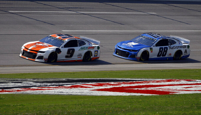 Chase Elliott (9) leads Monster Energy NASCAR Cup Series driver Alex Bowman (88) through the trip oval to win Stage 2 during a NASCAR Cup Series auto race at Talladega Superspeedway, Sunday, April 28, 2019, in Talladega, Ala. (AP Photo/Butch Dill)