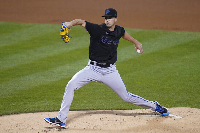 Miami Marlins starting pitcher Trevor Rogers throws during the first inning during the second baseball game of the team's doubleheader against the New York Mets, Tuesday, Aug. 25, 2020, in New York. Rogers made his debut in the majors. (AP Photo/John Minchillo)