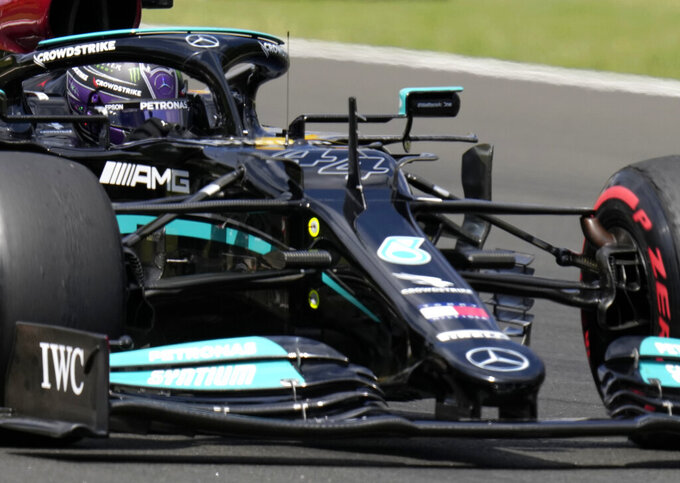 Mercedes driver Lewis Hamilton of Britain steers his car during the third free practice session for the Hungarian Formula One Grand Prix at the Hungaroring racetrack in Mogyorod, Hungary, Saturday, July 31, 2021. The Hungarian Formula One Grand Prix will be held on Sunday. (AP Photo/Darko Bandic)
