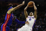 Philadelphia 76ers' Zhaire Smith (8) shoots as Detroit Pistons' Bruce Brown defends during the second half of an NBA preseason basketball game Tuesday, Oct. 15, 2019, in Philadelphia. The 76ers won 106-86. (AP Photo/Matt Rourke)