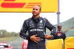 Mercedes driver Lewis Hamilton of Britain after taking pole position during qualifying practice for Sunday's Emilia Romagna Formula One Grand Prix, at the Imola track, Italy, Saturday, April 17, 2021. (Bryn Lennon/Pool photo via AP)