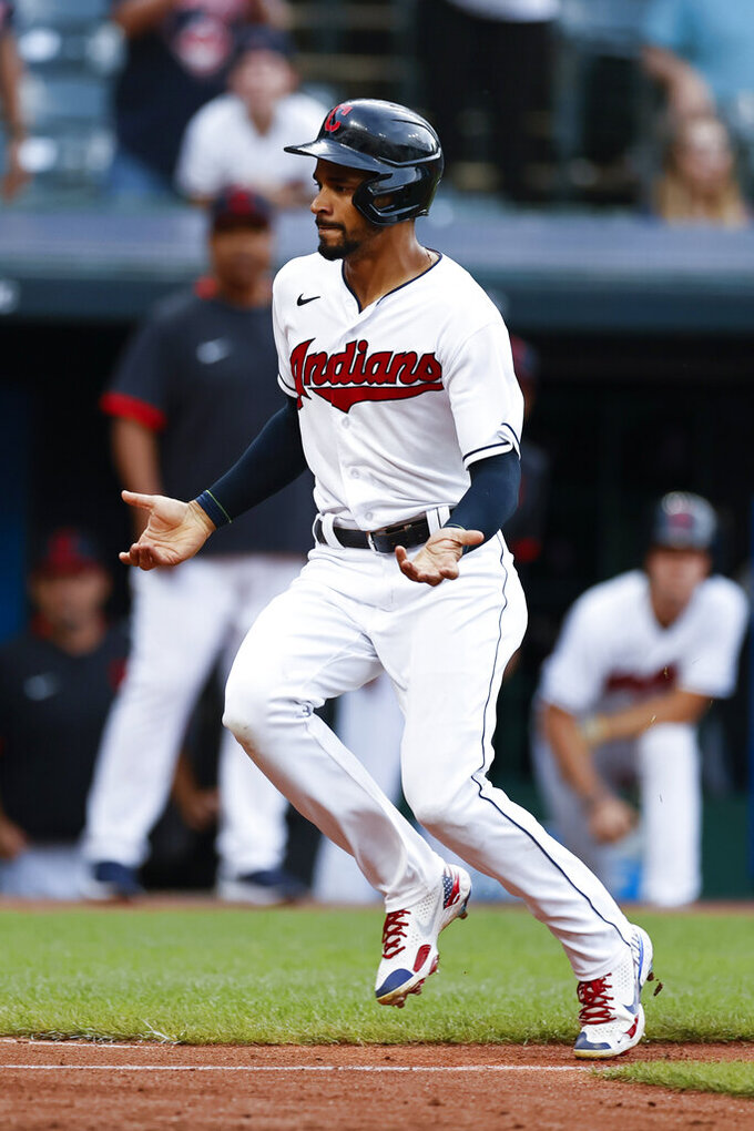 Cleveland Indians' Oscar Mercado scores on a double by Yu Chang during the eighth inning of a baseball game against the Boston Red Sox, Sunday, Aug. 29, 2021, in Cleveland. (AP Photo/Ron Schwane)