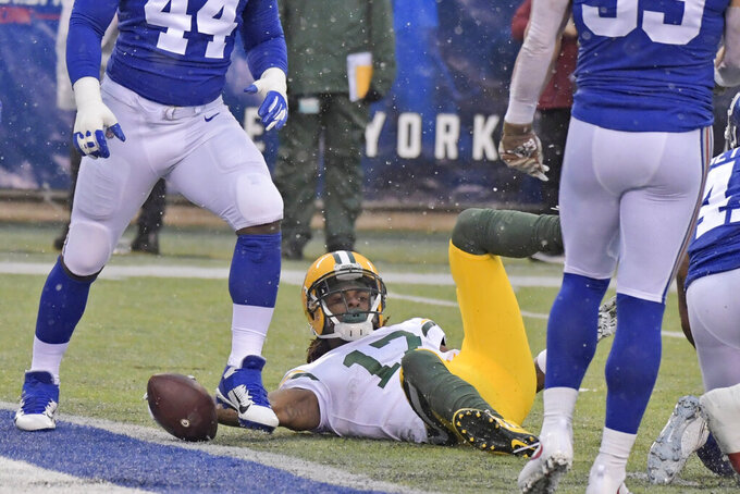 Green Bay Packers' Davante Adams reacts after scoring a touchdown during the first half of an NFL football game against the New York Giants, Sunday, Dec. 1, 2019, in East Rutherford, N.J. (AP Photo/Bill Kostroun)
