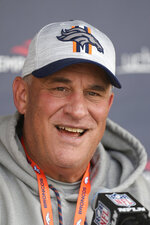 Denver Broncos head coach Vic Fangio jokes with reporters after an NFL football training camp practice at the team's headquarters Tuesday, Aug. 10, 2021, in Englewood, Colo. (AP Photo/David Zalubowski)