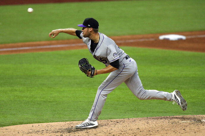 Colorado Rockies pitcher Daniel Bard delivers in the fifth inning against the Texas Rangers in a baseball game Saturday, July 25, 2020, in Arlington, Texas. (AP Photo/Richard W. Rodriguez)