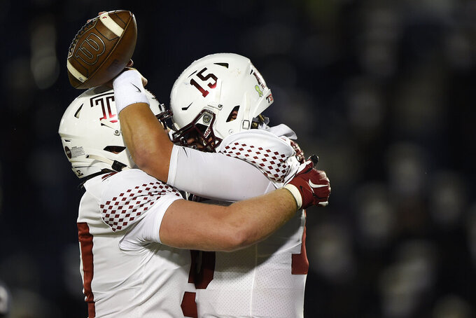 Temple's Anthony Russo, right, celebrates his touchdown against Navy with Michael Niese during the first half of an NCAA college football game Saturday, Oct. 10, 2020, in Annapolis, Md. (AP Photo/Gail Burton)