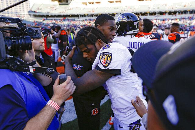 Baltimore Ravens quarterback Lamar Jackson (8), center right, hugs Cincinnati Bengals wide receiver A.J. Green, center left, after an NFL football game, Sunday, Nov. 10, 2019, in Cincinnati. (AP Photo/Frank Victores)