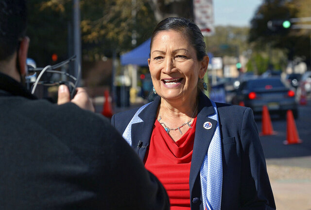 Democratic Congresswomen Deb Haaland, N.M.-1st Dist., does a PSA for her twitter account in downtown Albuquerque, N.M., on Tuesday, Nov. 3, 2020. Haaland faces a challenge from Republican candidate Michelle Garcia Holmes in Tuesday's election. (Jim Thompson/The Albuquerque Journal via AP)