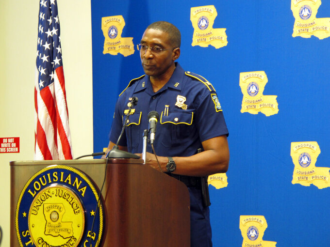 Louisiana State Police leader Col. Lamar Davis speaks to reporters amid a widening federal investigation into state police misconduct, on Friday, Sept. 10, 2021, in Baton Rouge, La. (AP Photo/Melinda Deslatte)